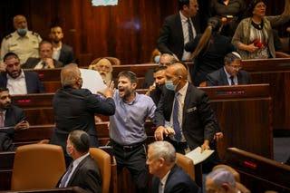 Bezalel Smotrich interrupts Naftali Bennett's speech in the Knesset, Sunday.