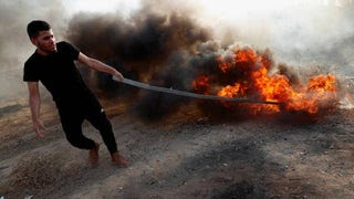 Palestinian demonstrator along the Gaza border fence, last week.